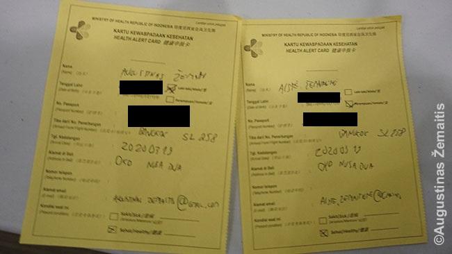 Lapelis, kurį pasieniečiai nurodė laikyti pase visą laiką, kol būsiu Indonezijoje. Ant jo - informacija, kur skambinti susirgus koronavirusu