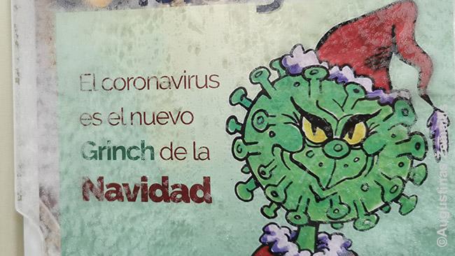 Atsišaukimas daugiabučio laiptinėje, kur gyvenome: 'Koronavirusas - naujasis Kalėdų Grinčas'