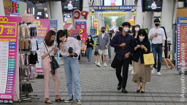 Žmonės Tedžono gatvėje